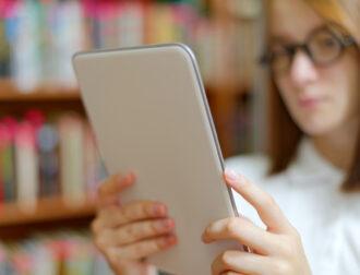 girl-holding-tablet-PB924D4
